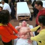 marjorie brook demonstrating scar tissue release therapy on abdomen